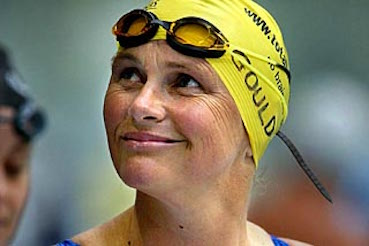 Shane Elizabeth Gould, MBE (born 23 November 1956) is an Australian former competition swimmer who won three gold medals, a silver medal and a bronze at the 1972 Summer Olympics. She is the only person, male or female, to hold every world freestyle record from 100 metres to 1500 metres and the 200-metre individual medley world record simultaneously, which she did from 12 December 1971 to 1 September 1972. She is the first female swimmer ever to win three Olympic gold medals in world record time, and the first swimmer, male or female, to win Olympic medals in five individual events in a single Olympics.
