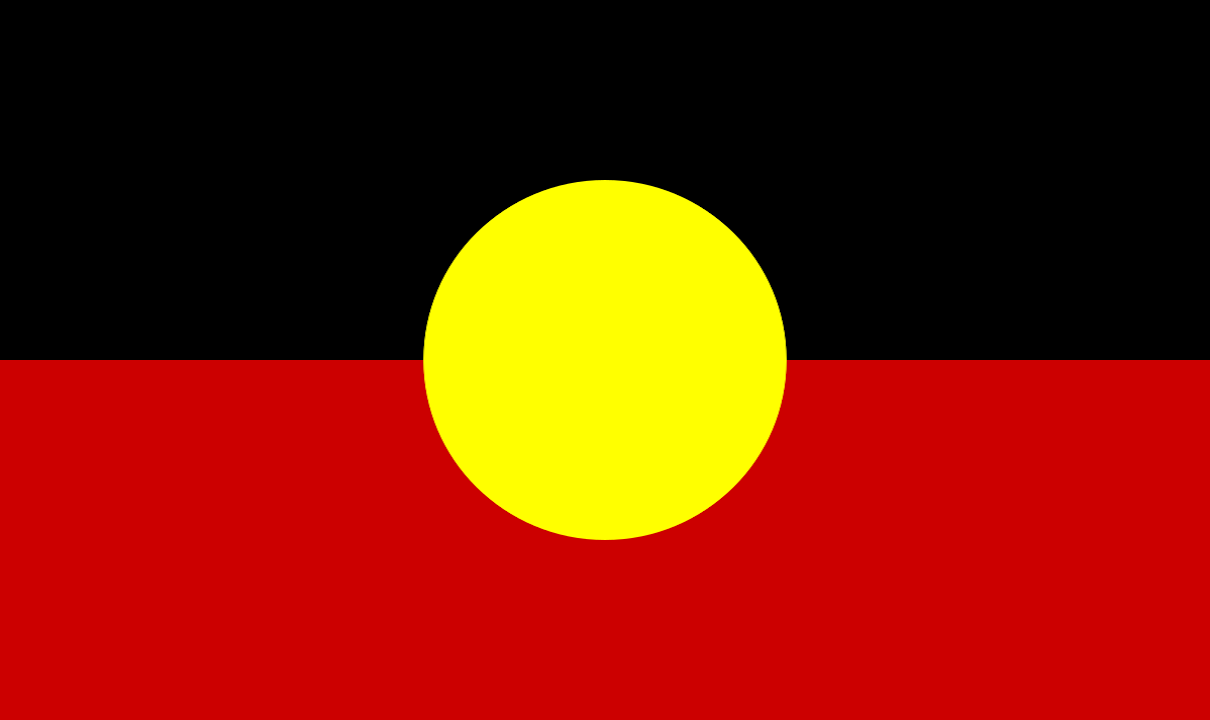 The Australian Aboriginal Flag represents Aboriginal Australians. It is one of the official flags of Australia, and holds special legal and political status. It is often flown together with the national flag and with the Torres Strait Islander Flag, which is also an official flag of Australia.  The Australian Aboriginal Flag was designed in 1971 by Aboriginal artist Harold Thomas, who is descended from the Luritja people of Central Australia and holds intellectual property rights to the flag's design. The flag was originally designed for the land rights movement, and it became a symbol of the Aboriginal people of Australia.  The flag's width is 1.5 times its height. It is horizontally divided into a black region (above) and a red region (below). A yellow disc is superimposed over the centre of the flag.  The symbolic meaning of the flag colours (as stated by Harold Thomas) is:  Black - represents the Aboriginal People of Australia  Yellow circle- represents the sun, giver of life and protector   Red - represents the red earth, the red ochre used in ceremonies and Aboriginal peoples' spiritual relation to the land